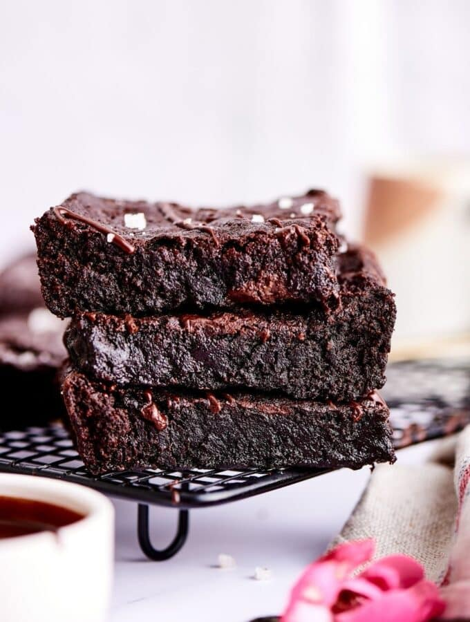 A stack of 3 brownies on a drying rack.