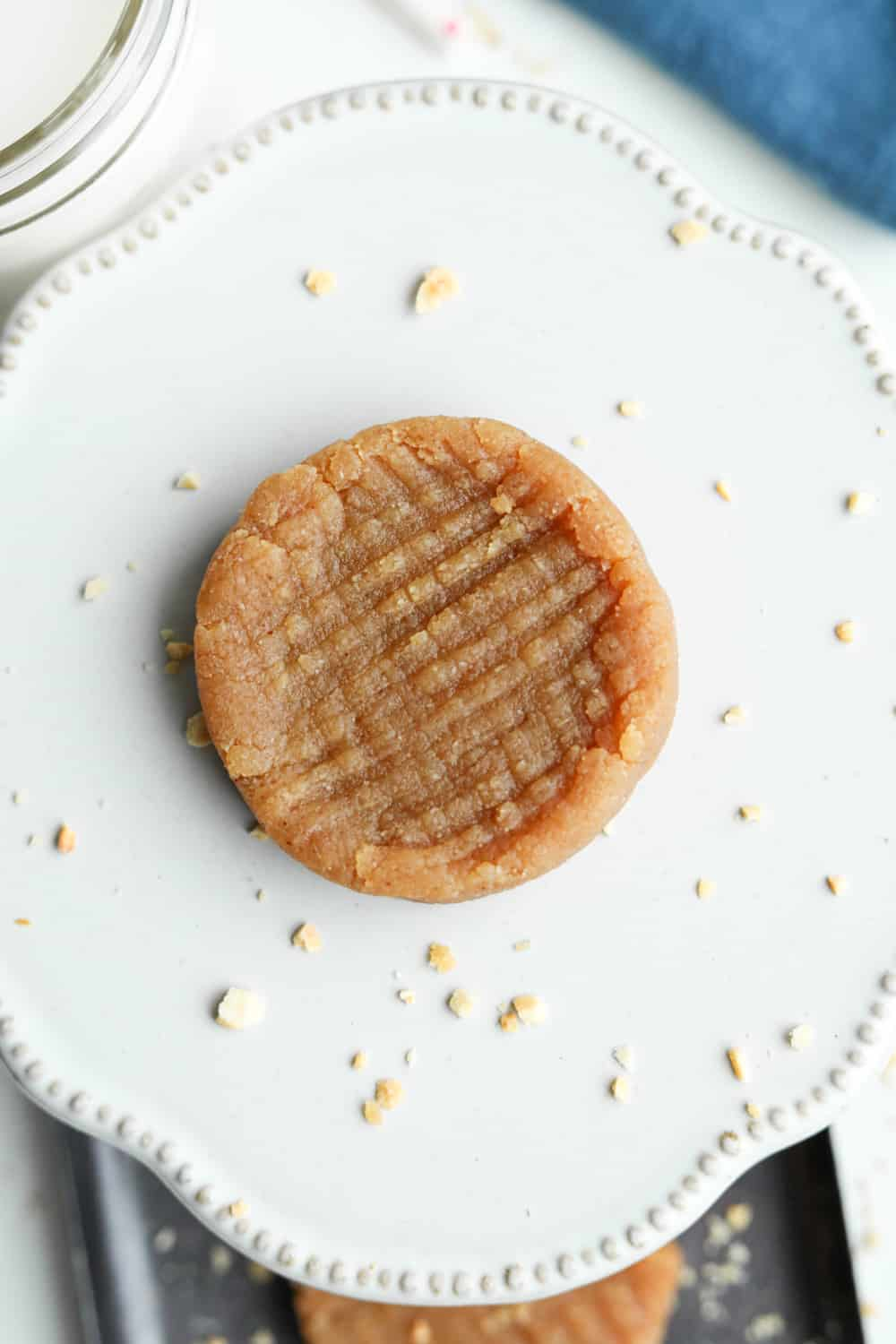 A peanut butter cookie on a plate.