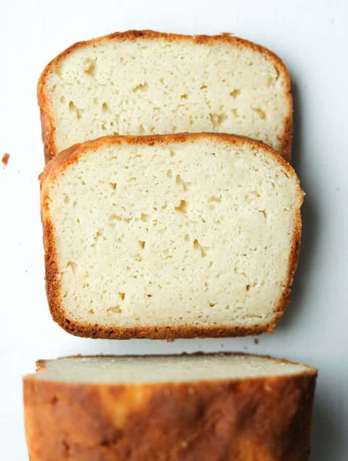 A loaf of bread cut into 2 slices that are laying on top of each other