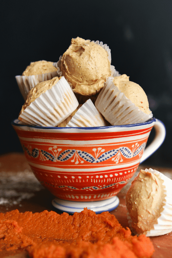 Pumpkin spice keto fat bombs in a cup.