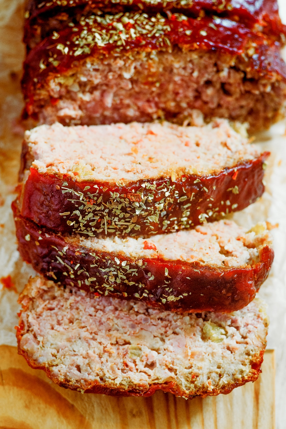 Meatloaf slices stacked on top of one another.