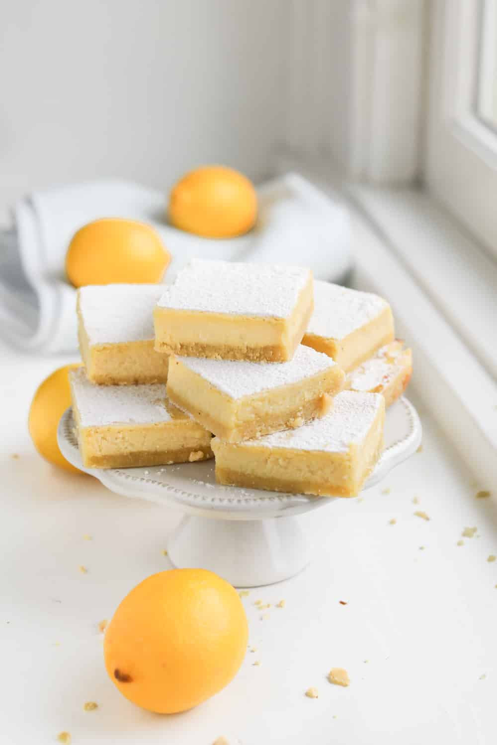 A stack of keto lemon bars on a serving plate.