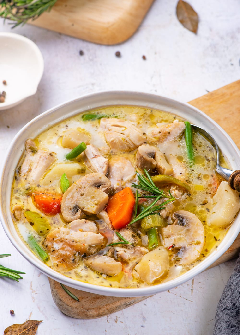 Chicken Stew In a bowl on a white table.