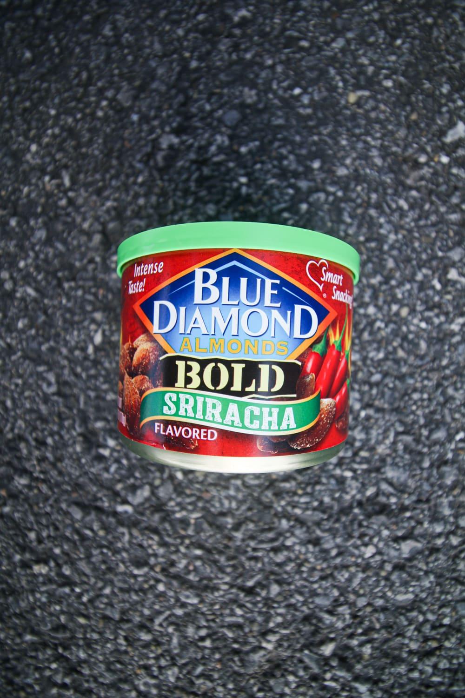 A container of sriracha almonds.