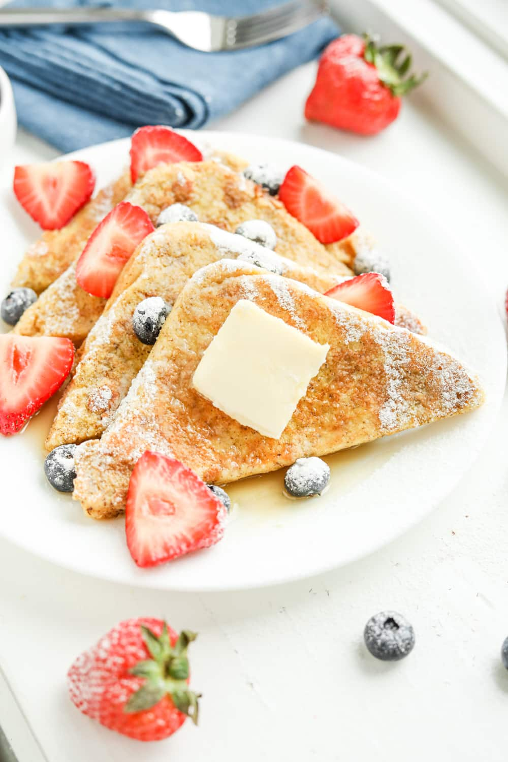 Slices of french toast on a white plate.