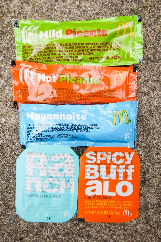 Packets of salsa & mayonnaise along with ranch dip & buffalo sauce dip from McDonalds.