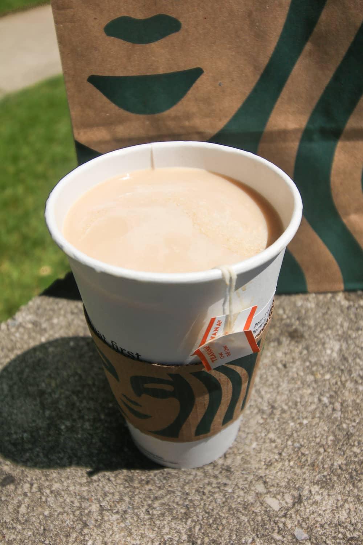 Chai tea in a paper cup.
