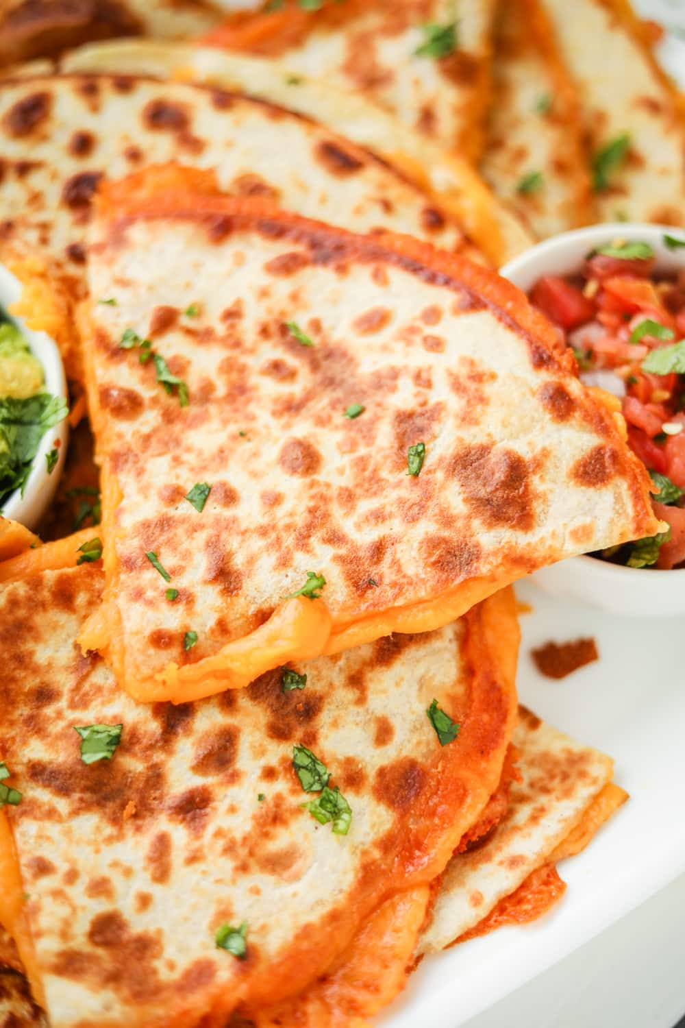 Quesadillas filled with cheese.