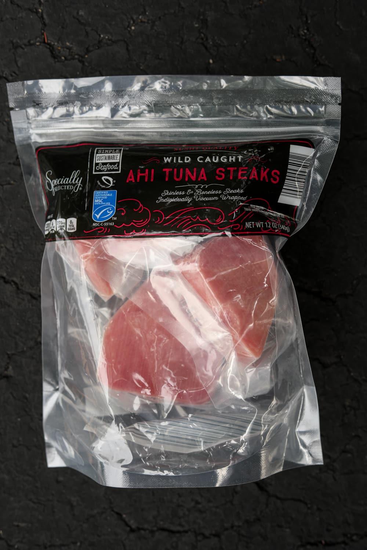 Frozen tuna filets in a clear plastic bag.
