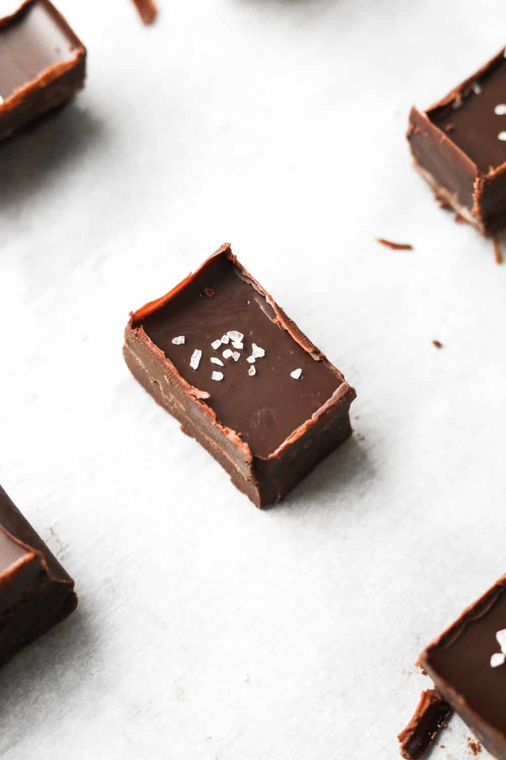 A piece of chocolate fudge on a white piece of paper.