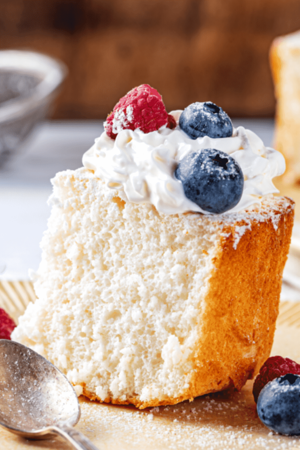 A piece of angel food cake on a plate.