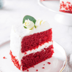 A piece of red velvet cake on a white plate.