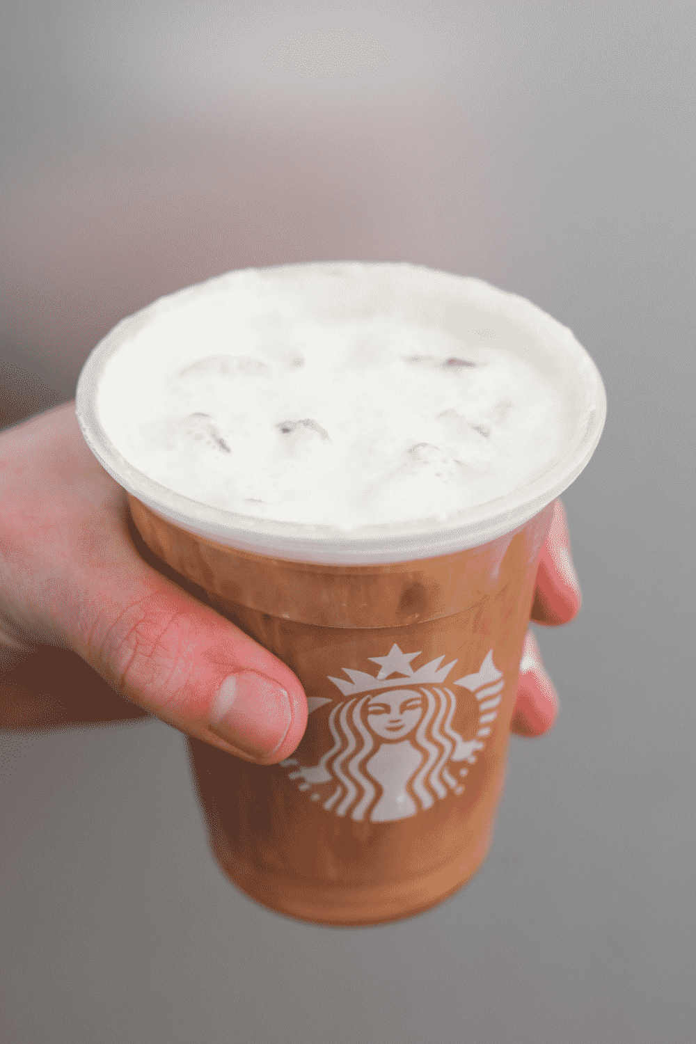 I had holding a cup of Starbucks salted caramel cream cold brew.