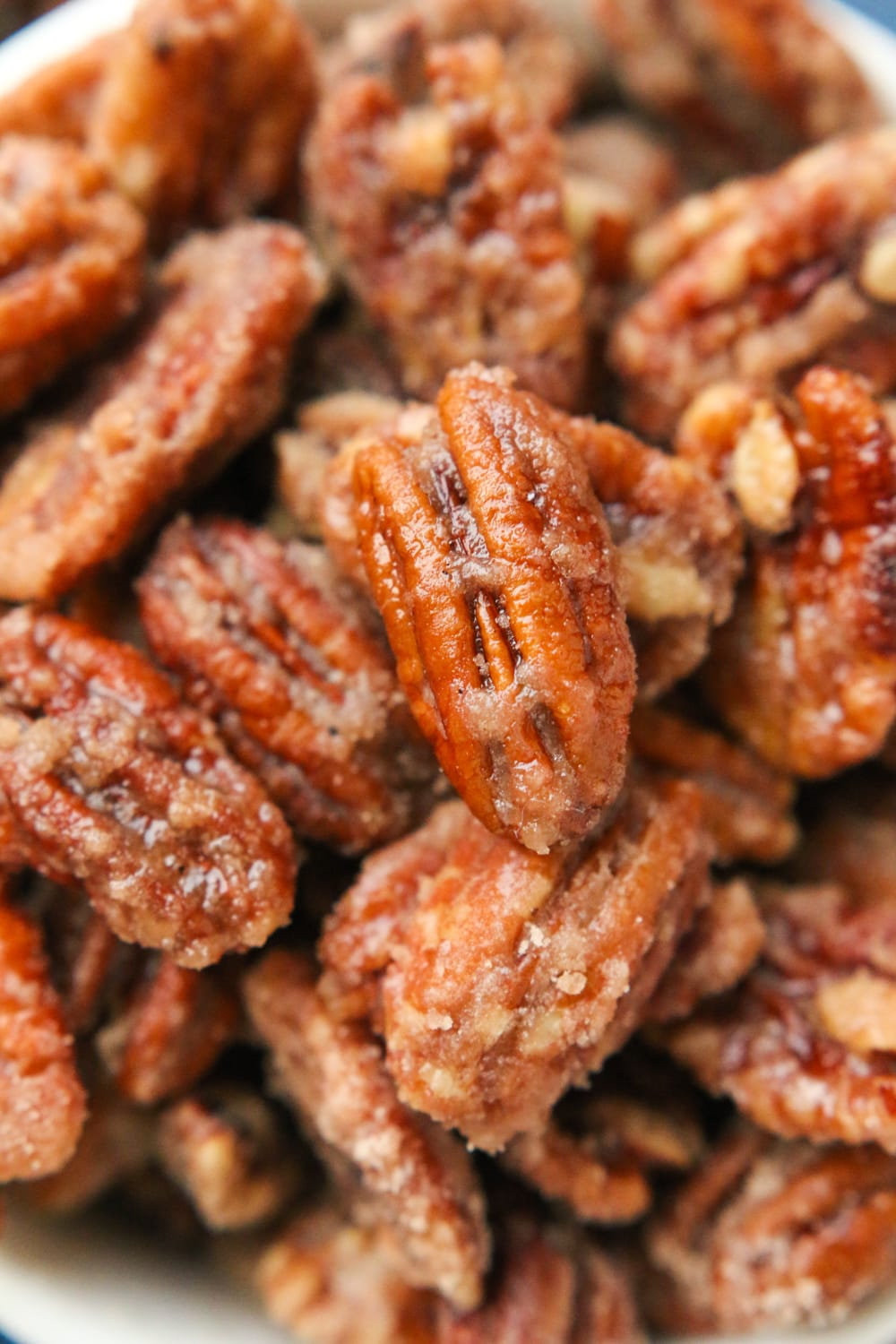 Candied pecans piled on top of one another.