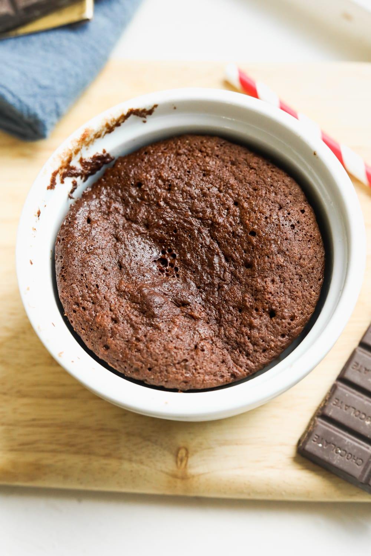 A chocolate mug cake in a white ramekin.