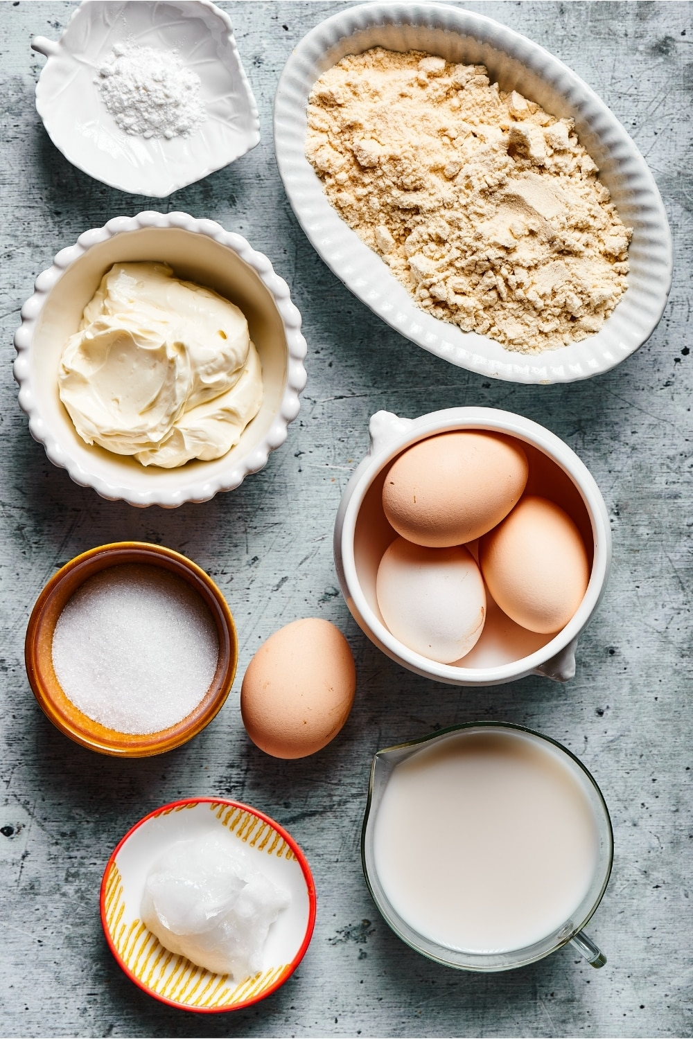 Ingredients for cream cheese pancakes and a gray counter.