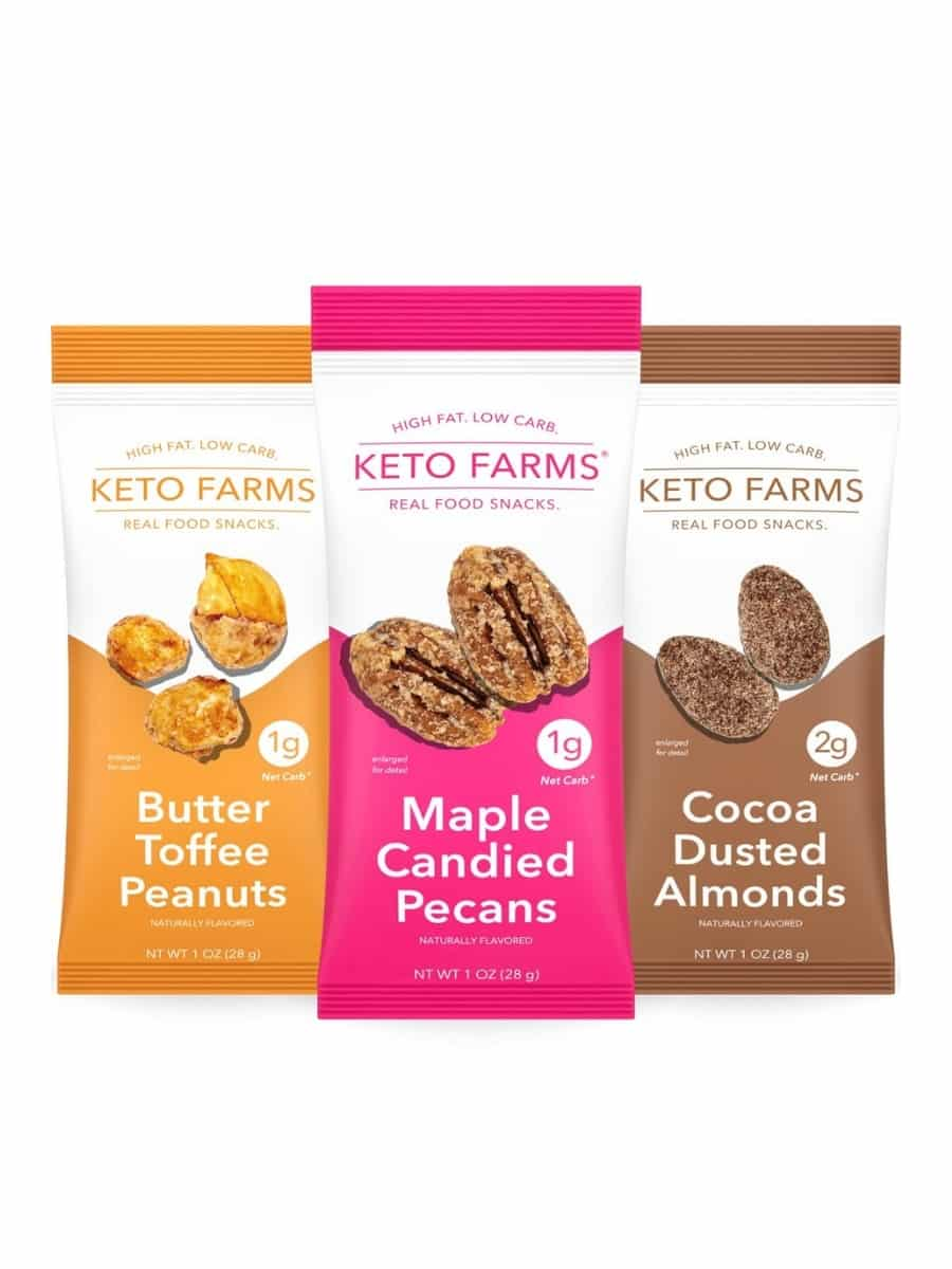 Three bags of keto farms real food snacks. The left is butter toffee peanuts, in the middle is maple candy pecans, and on the right is cocoa dusted almonds.