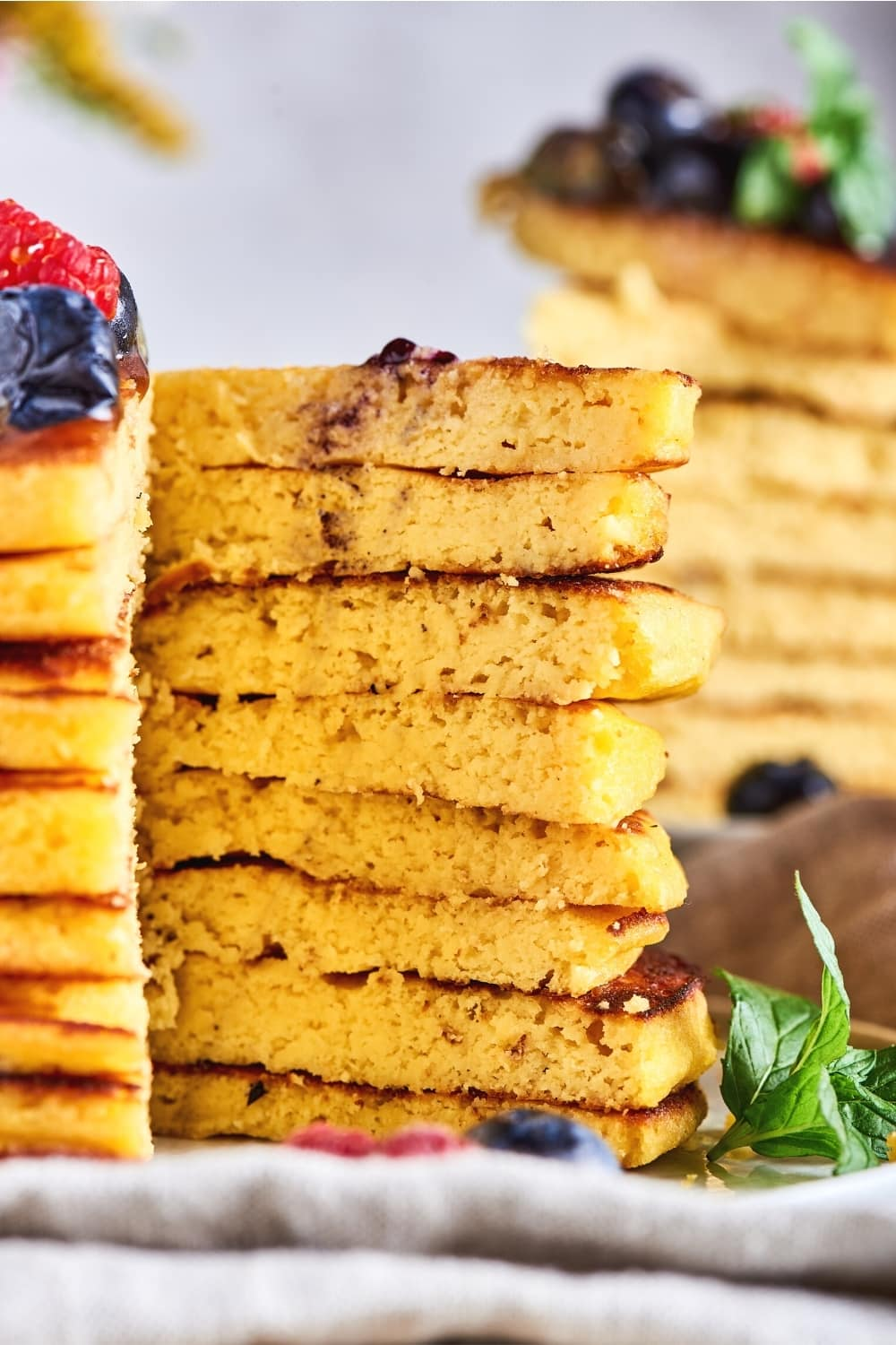 The inside of a stack of eight cream cheese pancakes.
