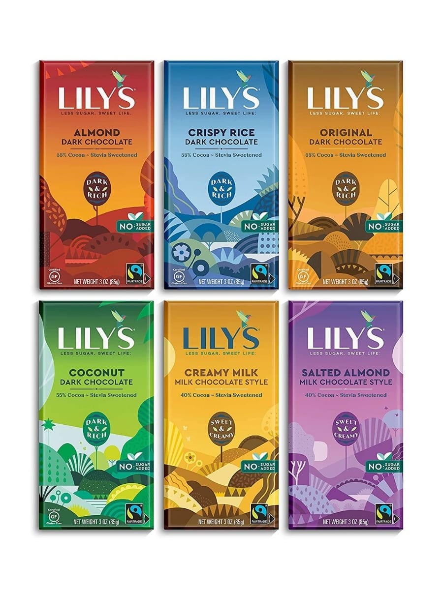 Six Lillys chocolate bars. There is almond dark chocolate, crispy rice dark chocolate, original dark chocolate, coconut dark chocolate, creamy milk milk chocolate style, and salted almond milk chocolate style.
