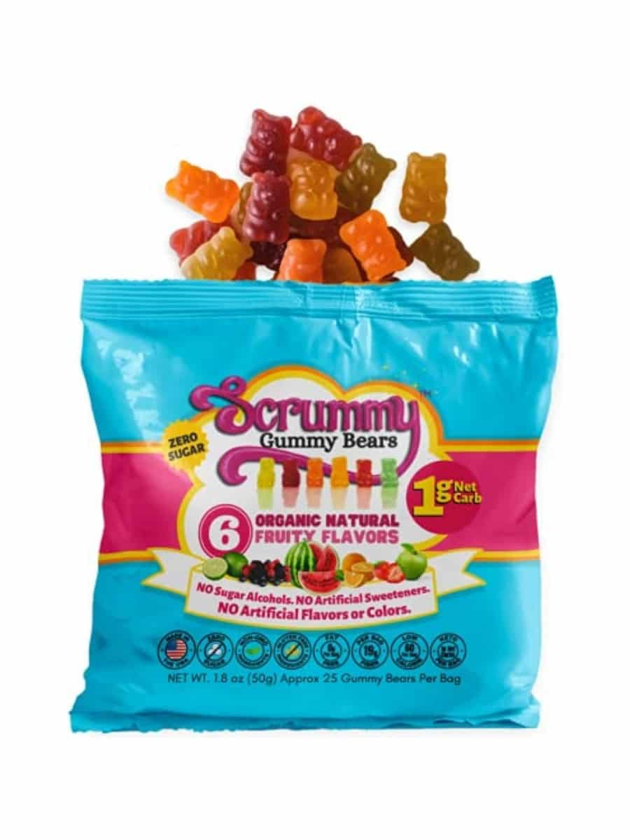 A bag of scrummy gummy bears. There are a bunch of gummy bears coming out of the top of the bag.