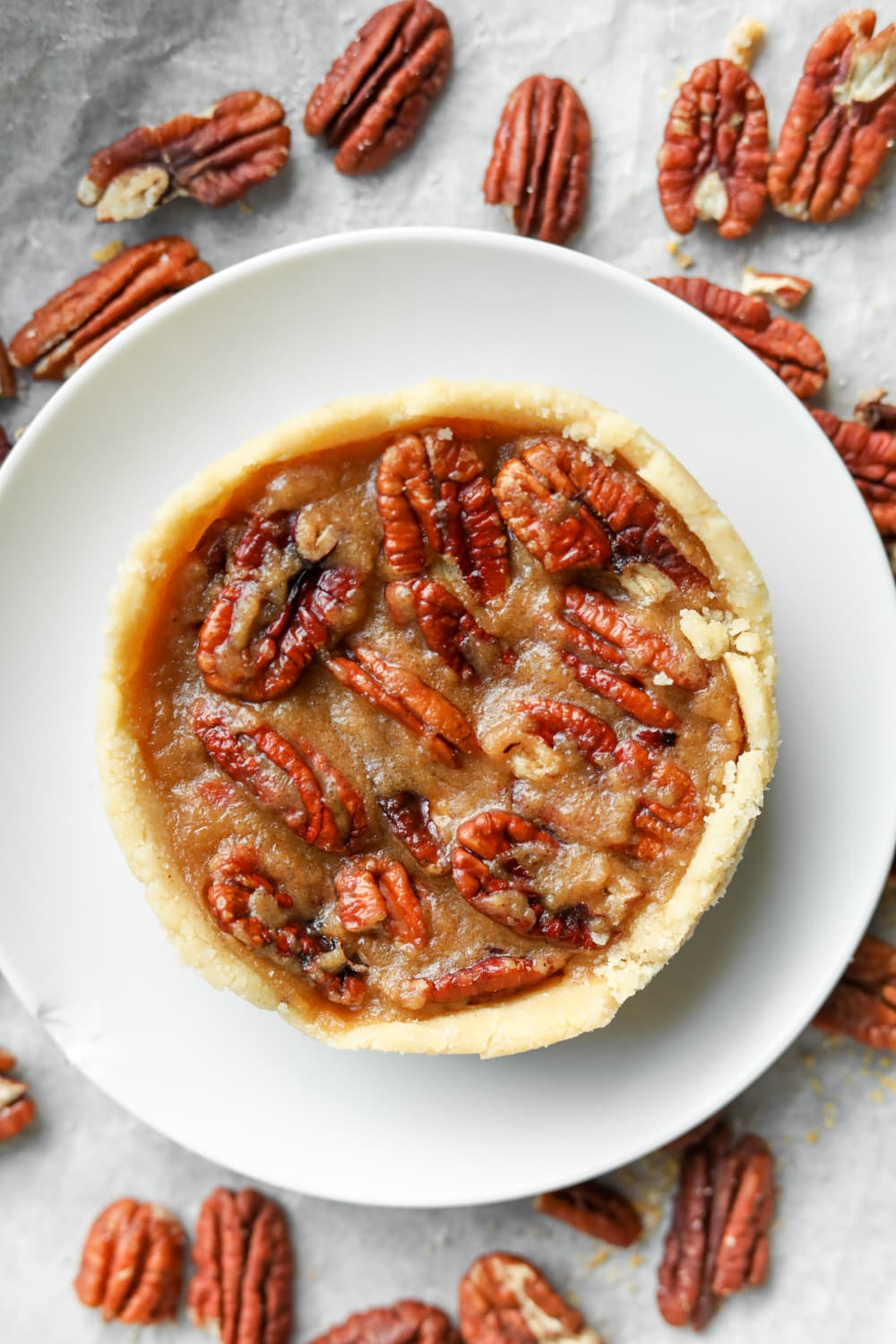 Pecan pie on a white plate.